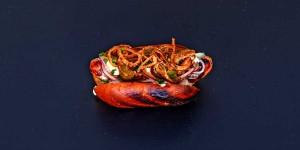 Der komplette Beckenrand Hotdog aus dem Odenwald mit Kochkäse und verschiedenen Toppings